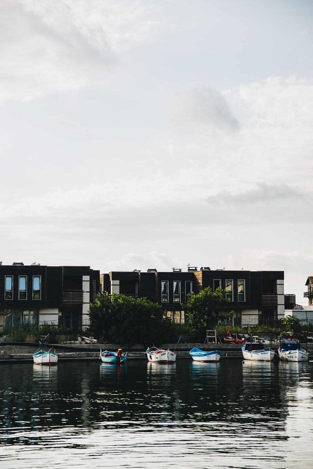 boat dock near building during daytime