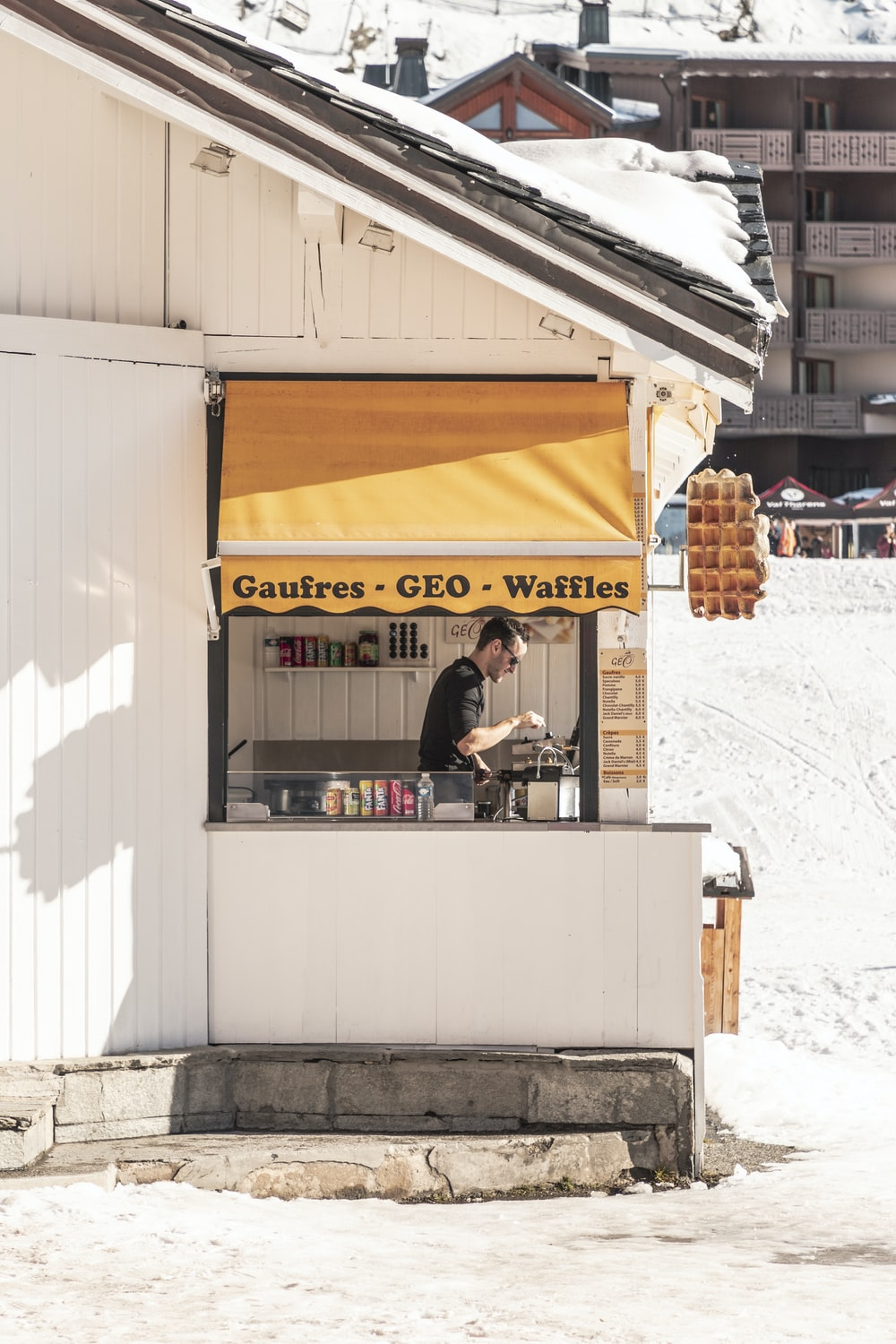 man on Gaufres Geo Waffles store during daytime
