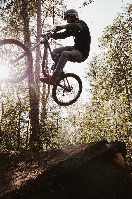 low angle photography of man riding BMX bike