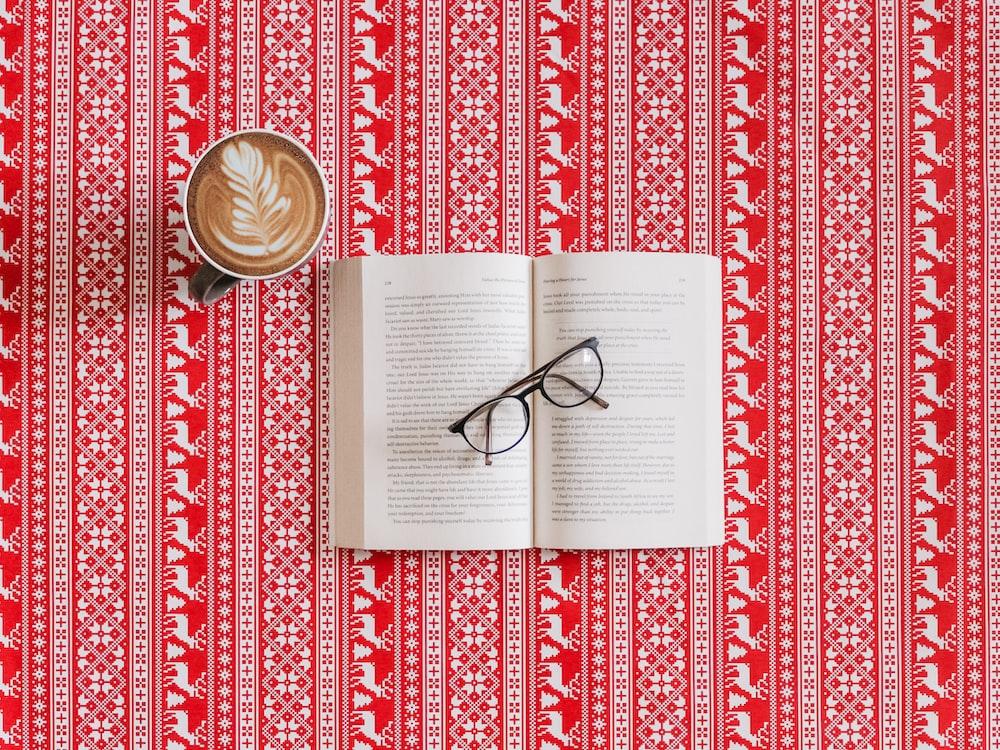 black frame eyeglasses on top of the book