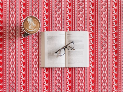 black frame eyeglasses on top of the book frosty the snowman teams background