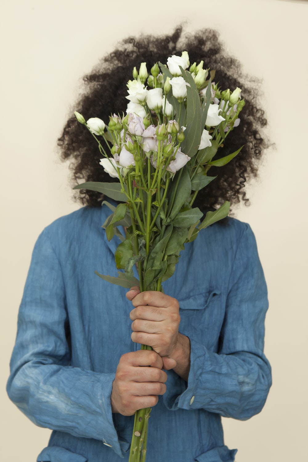 selective focus photography of person holding white tulip flower bouquet
