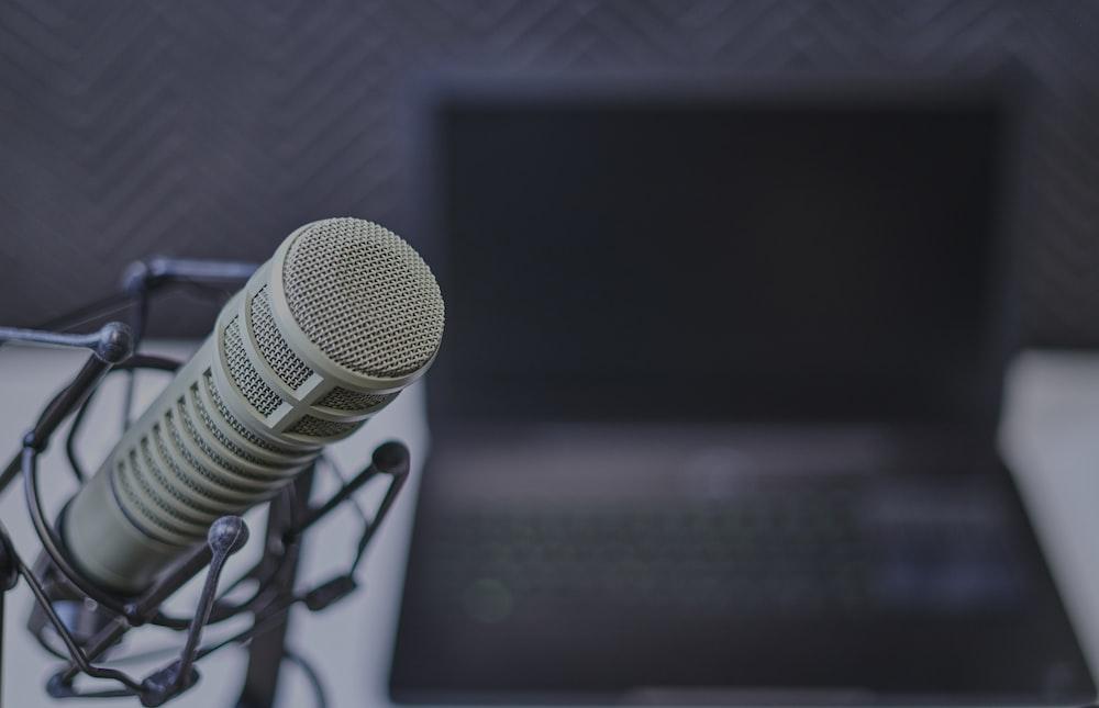 gray condenser microphone near laptop