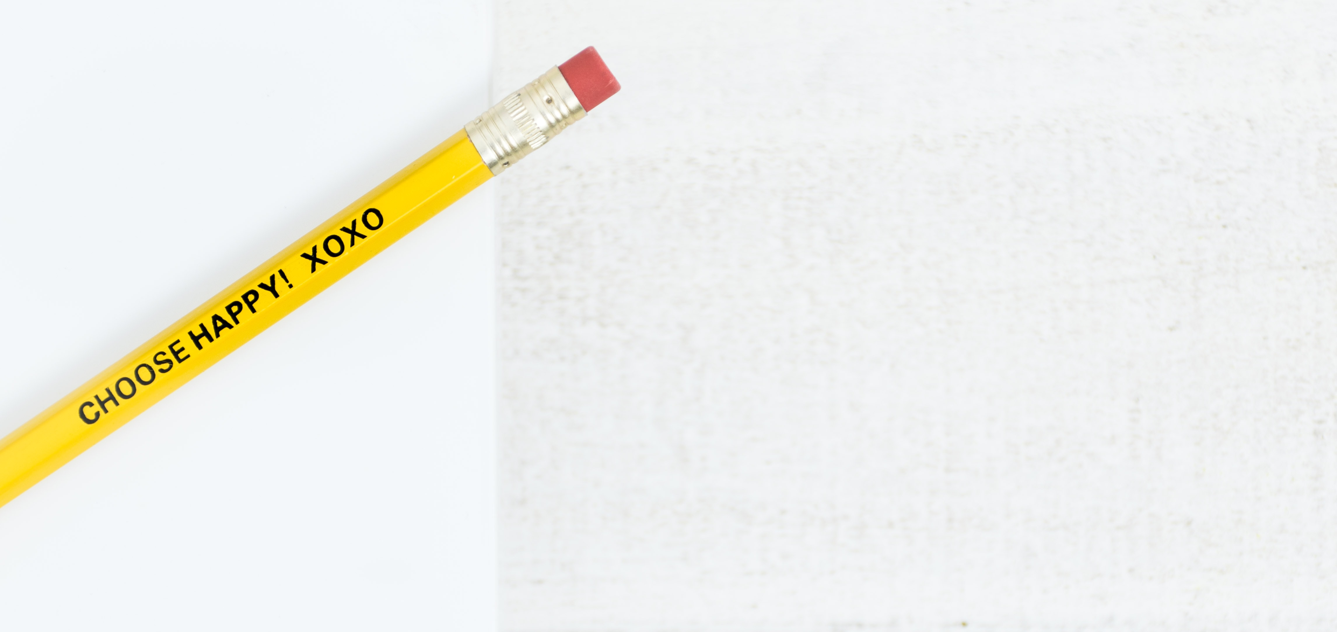 yellow and white click pen
