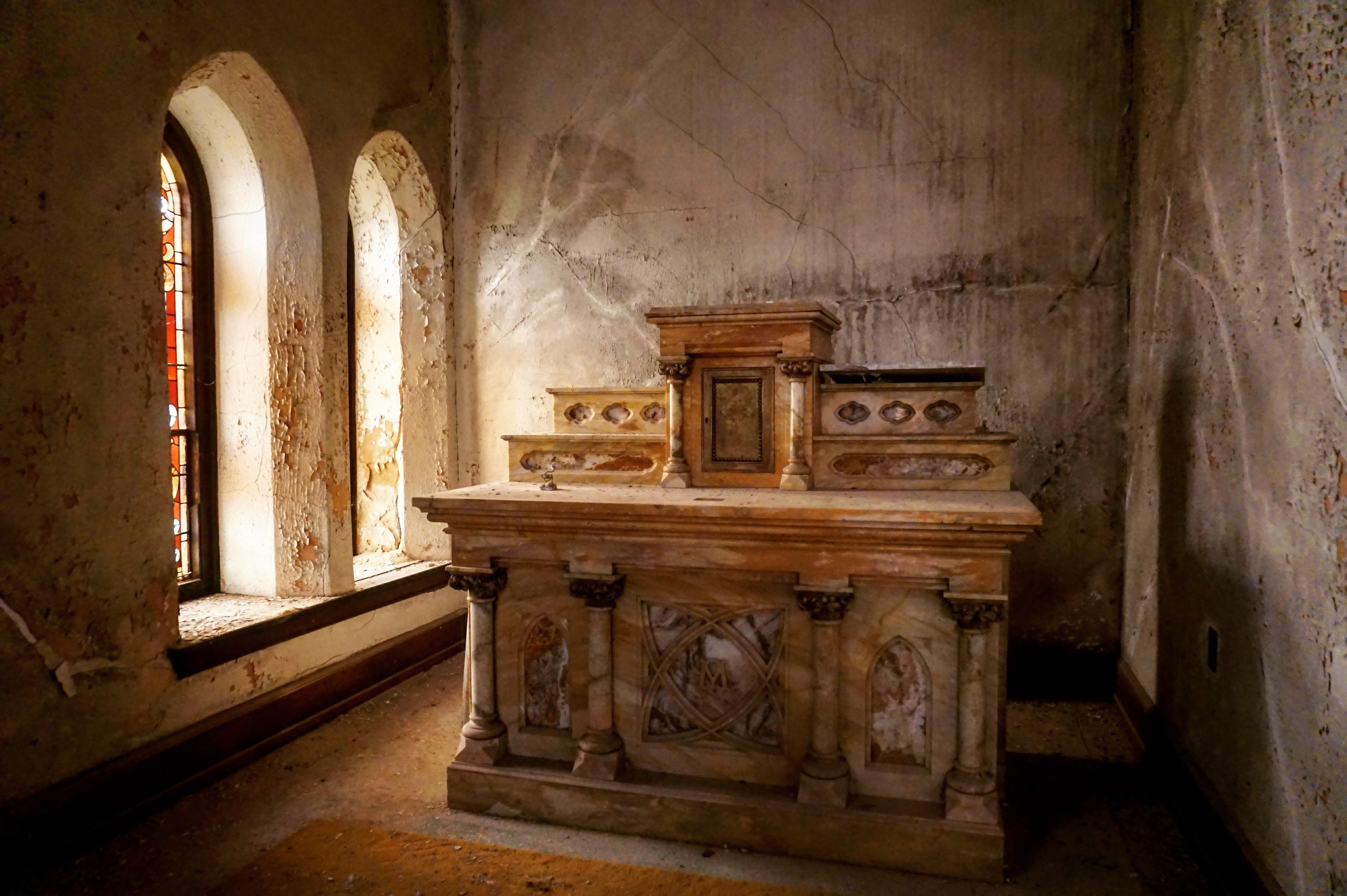 brown marble altar in room