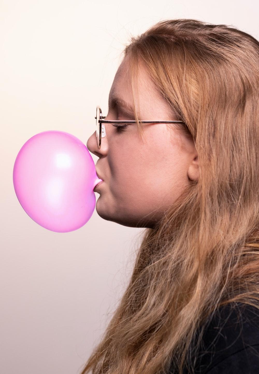 woman chewing bubblegum