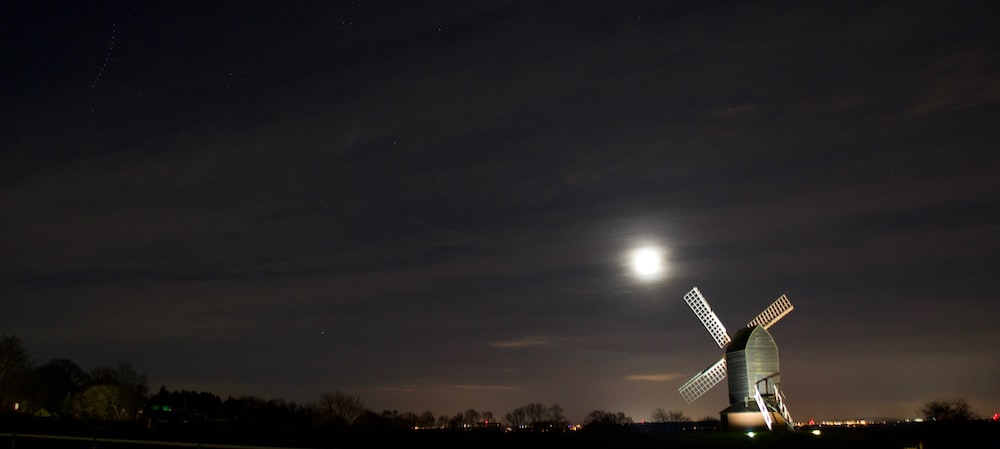 white windmill during nighttime