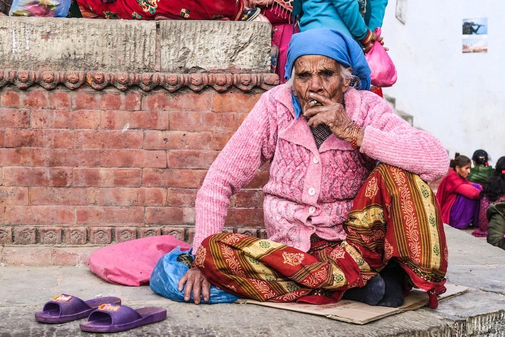 woman wearing pink cardigan