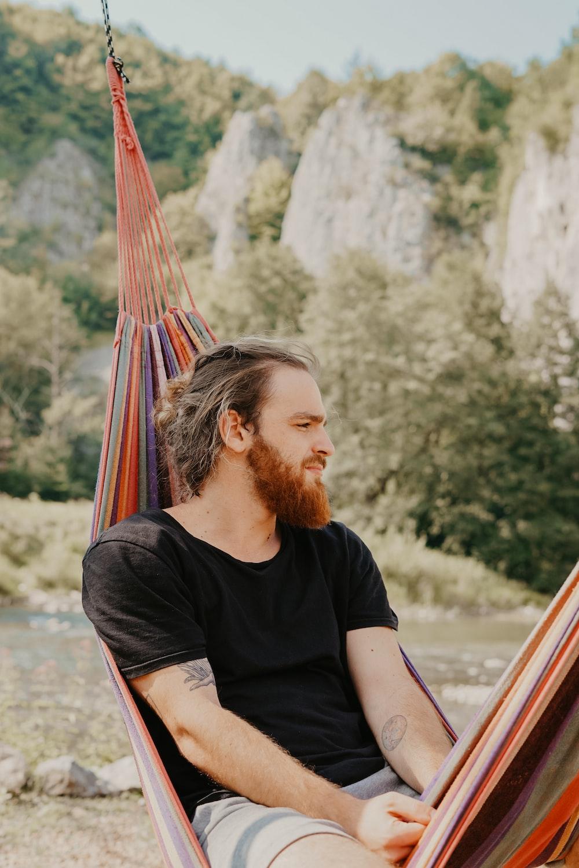man lying on hammock outdoors