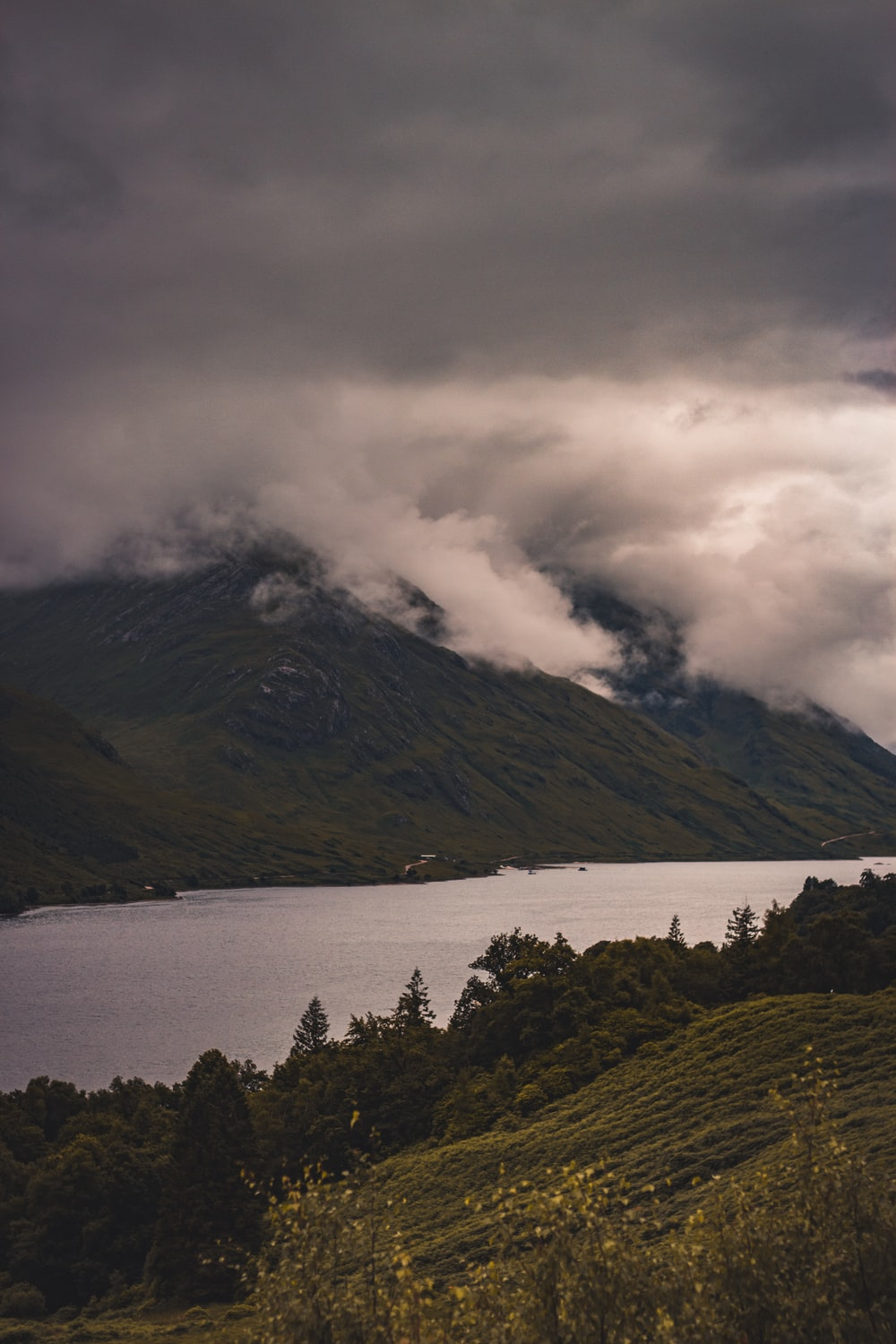 white clouds covering mountain during daytime