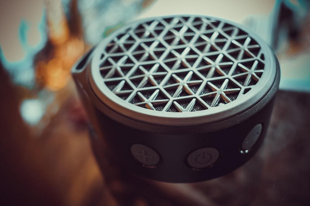round gray portable speaker