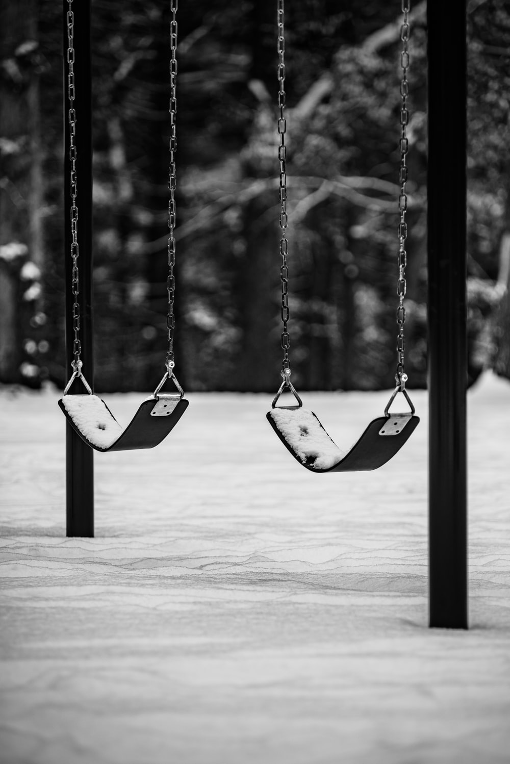 two swings with chain handles