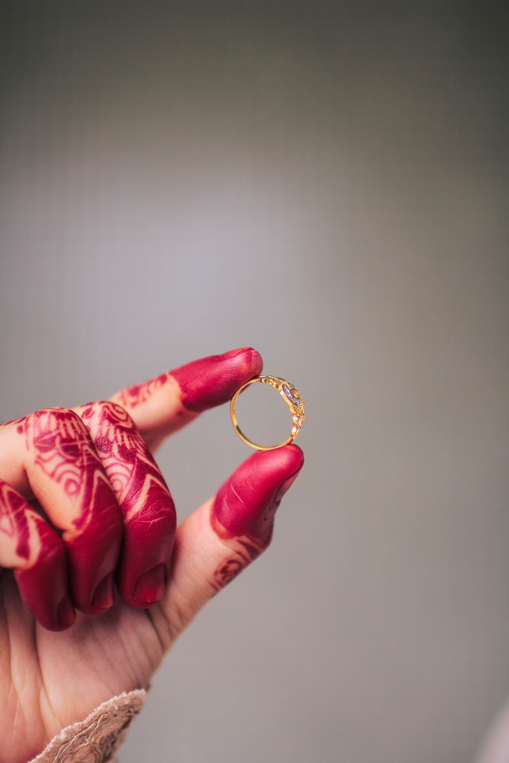 person holding gold-colored ring