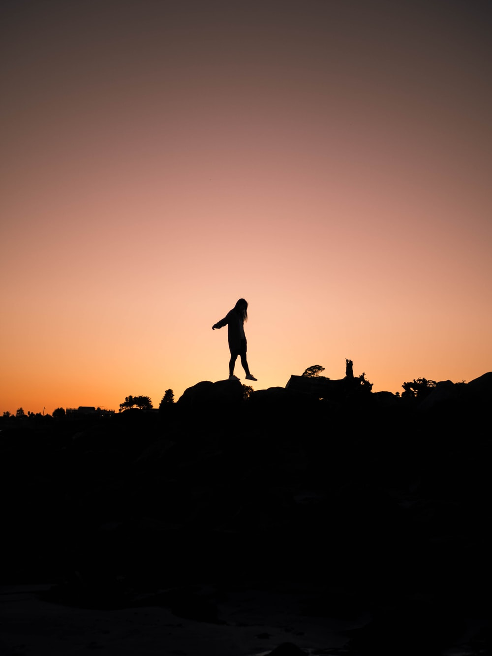 silhouette of girl during sunset