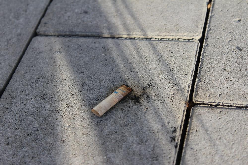 cigarette butt on floor
