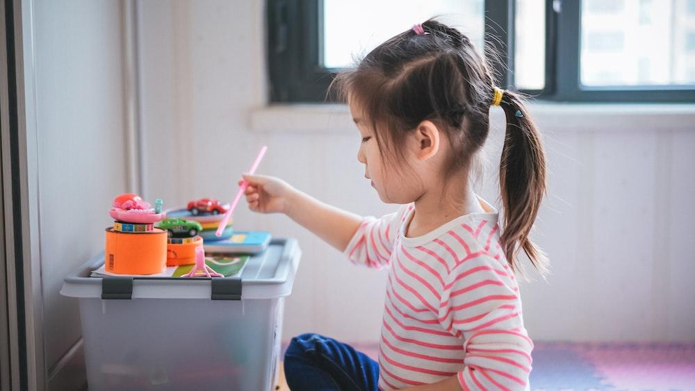 girl holding paint brush