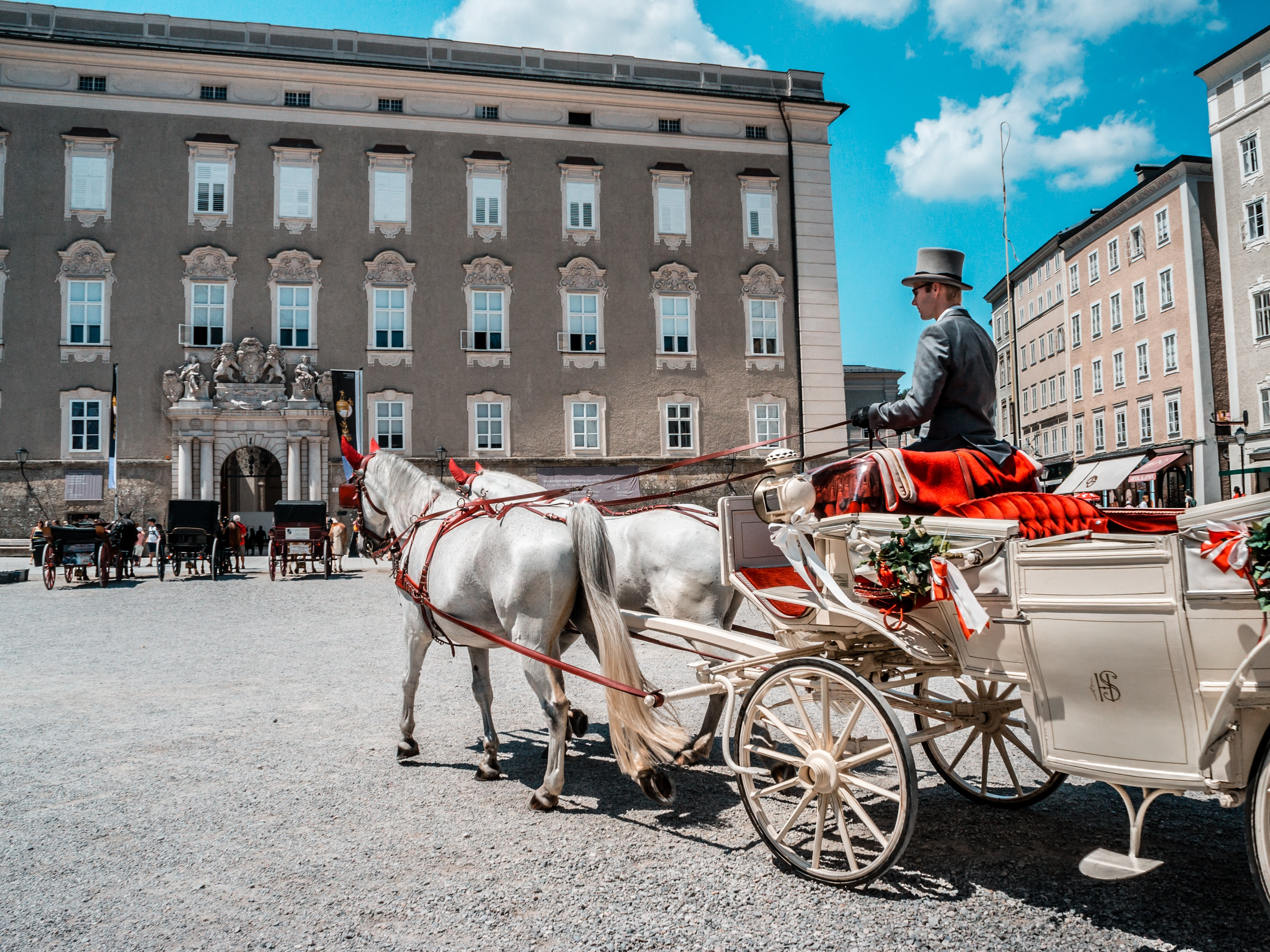 man riding on carriage