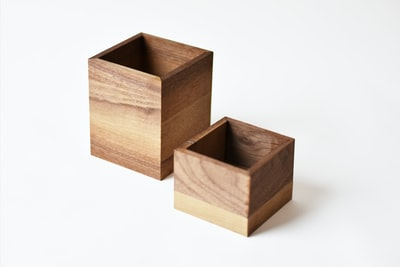 two brown wooden boxes