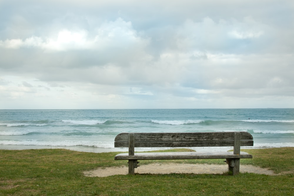 empty bench fronting sea