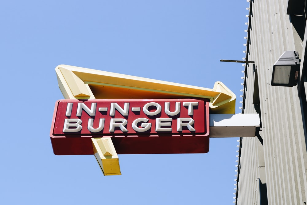 white In-N-Out Burger neon sign