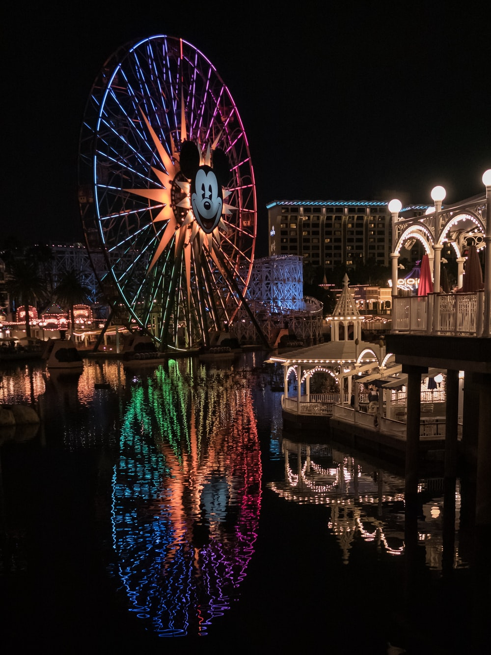 blue, pink, and orange Mickey Mouse ferries wheel at night time