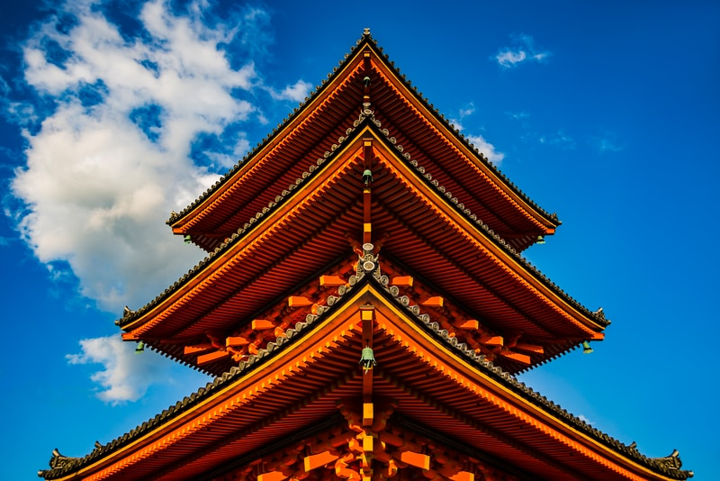 orange tower under white and blue sky