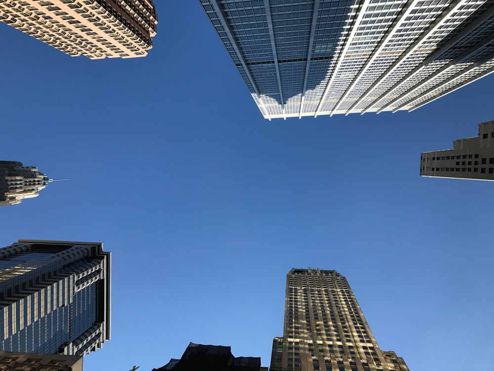 low angle photography of white and brown high-rise buildings during daytime