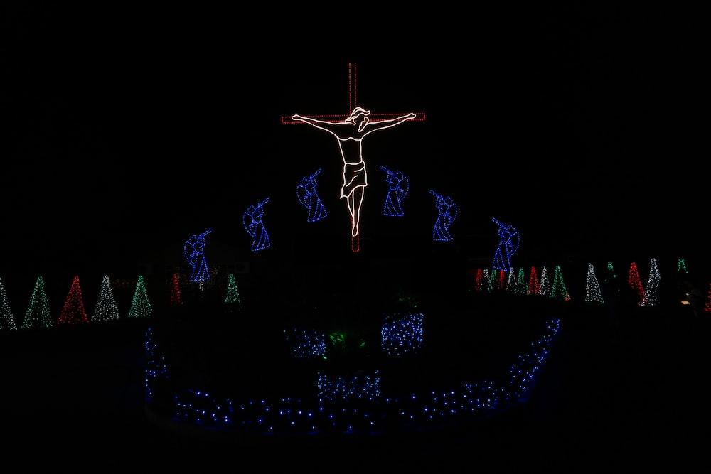 lighted Jesus Christ string light at night