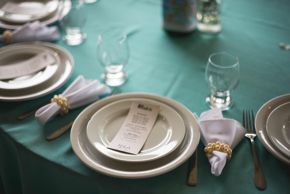 round white ceramic plates on table