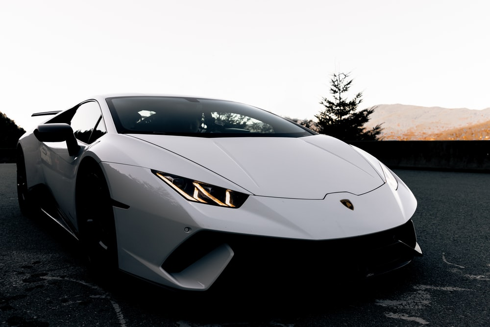 white sports coupe during day
