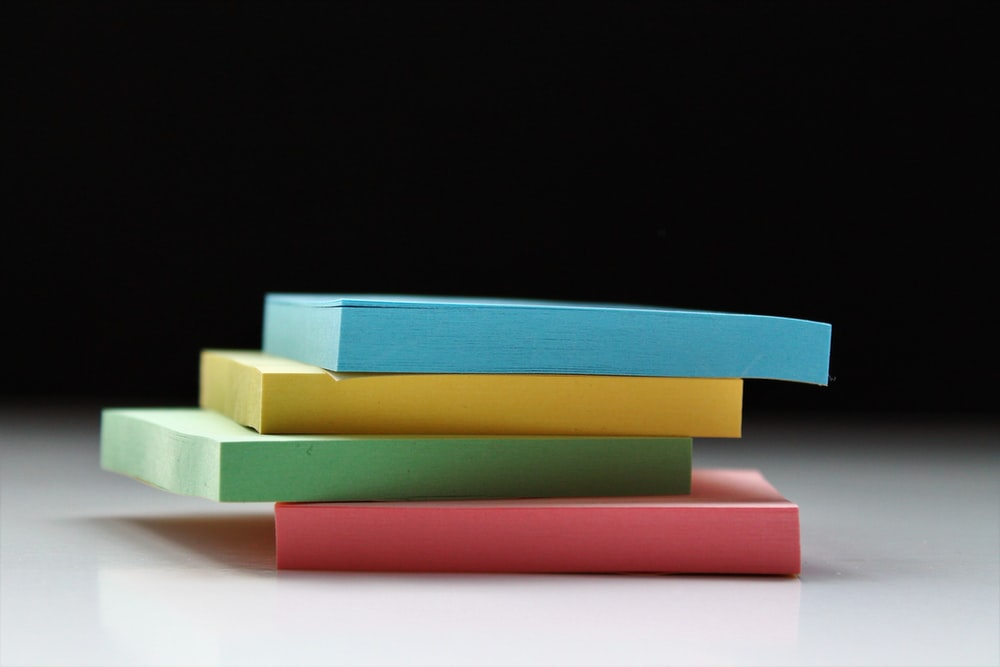 four assorted-color sticky notes