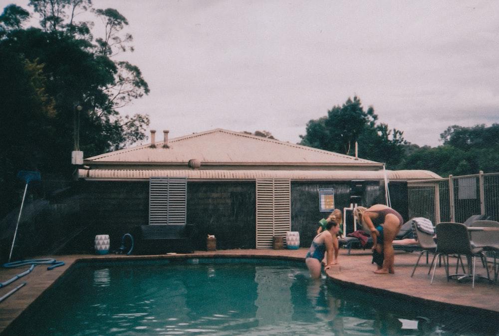 people near pool during daytime