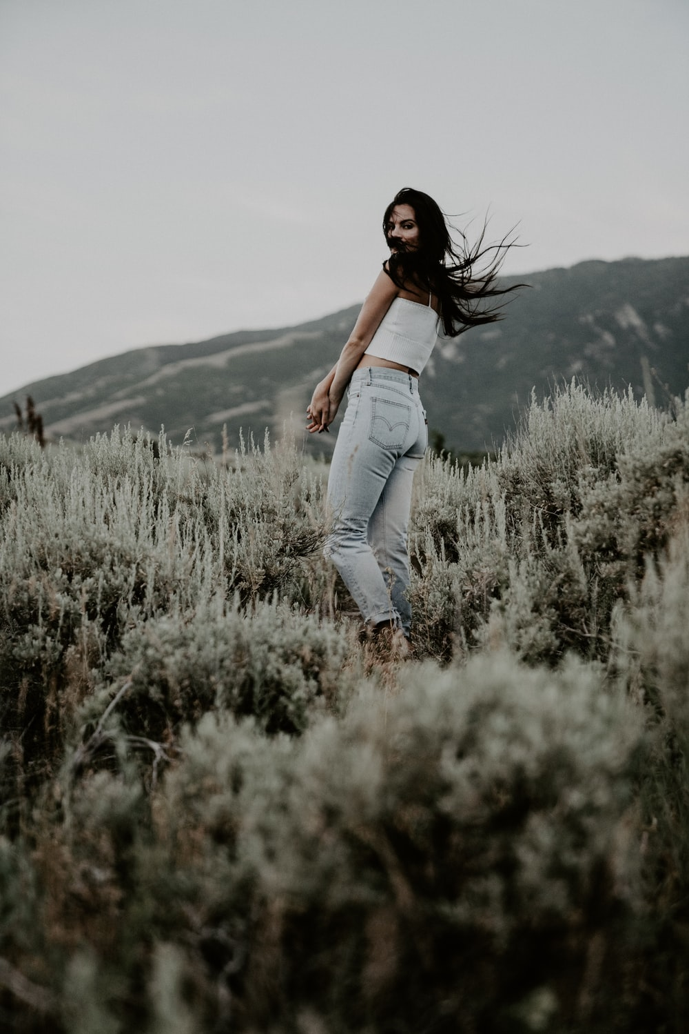 woman standing on grass during day