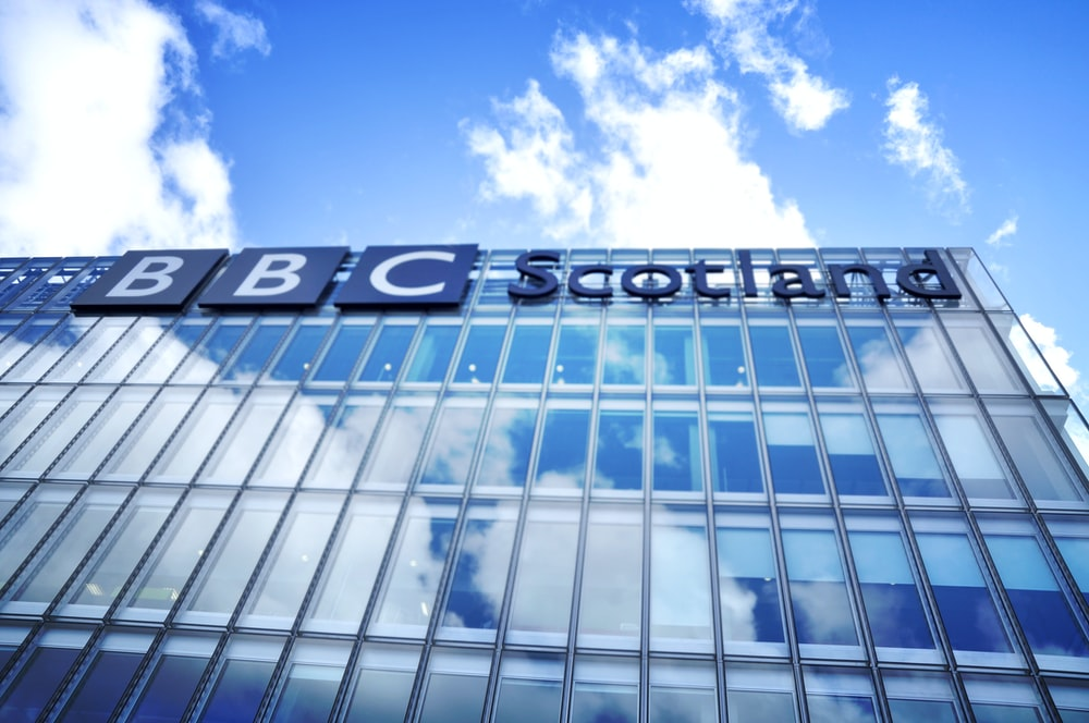 low angle photo of BBC Scotland building under blue sky