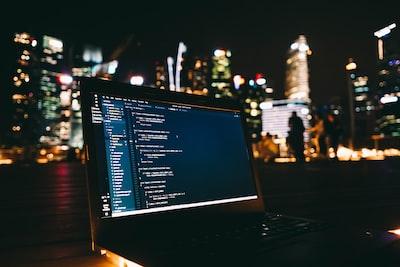 black laptop computer displaying blue screen programming zoom background