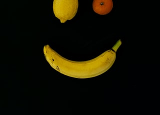 yellow lime, orange fruit, and yellow banana with smile formation