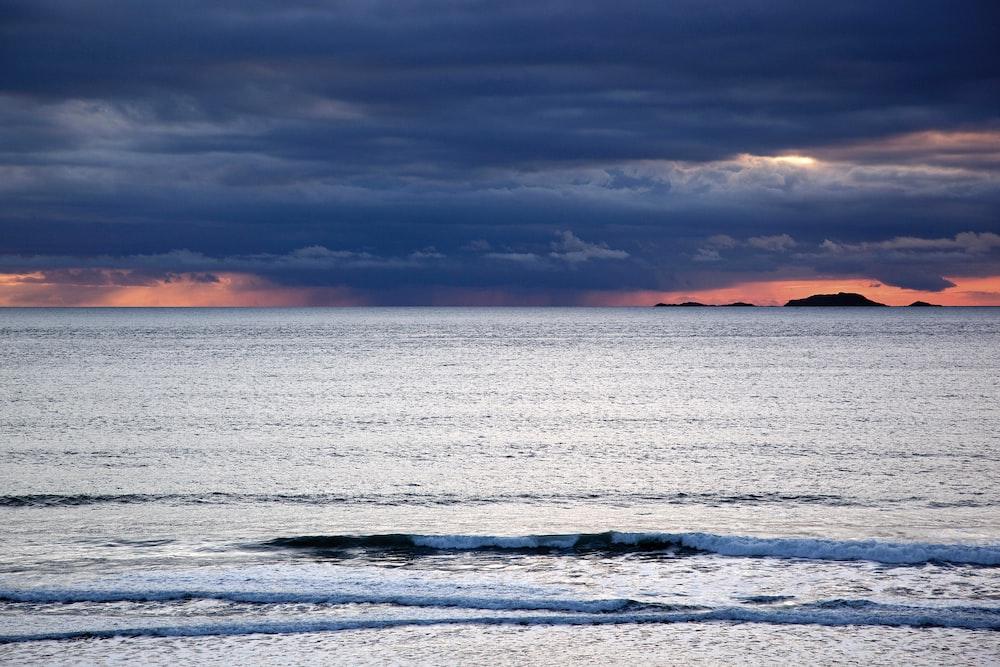 water waves under gray sky