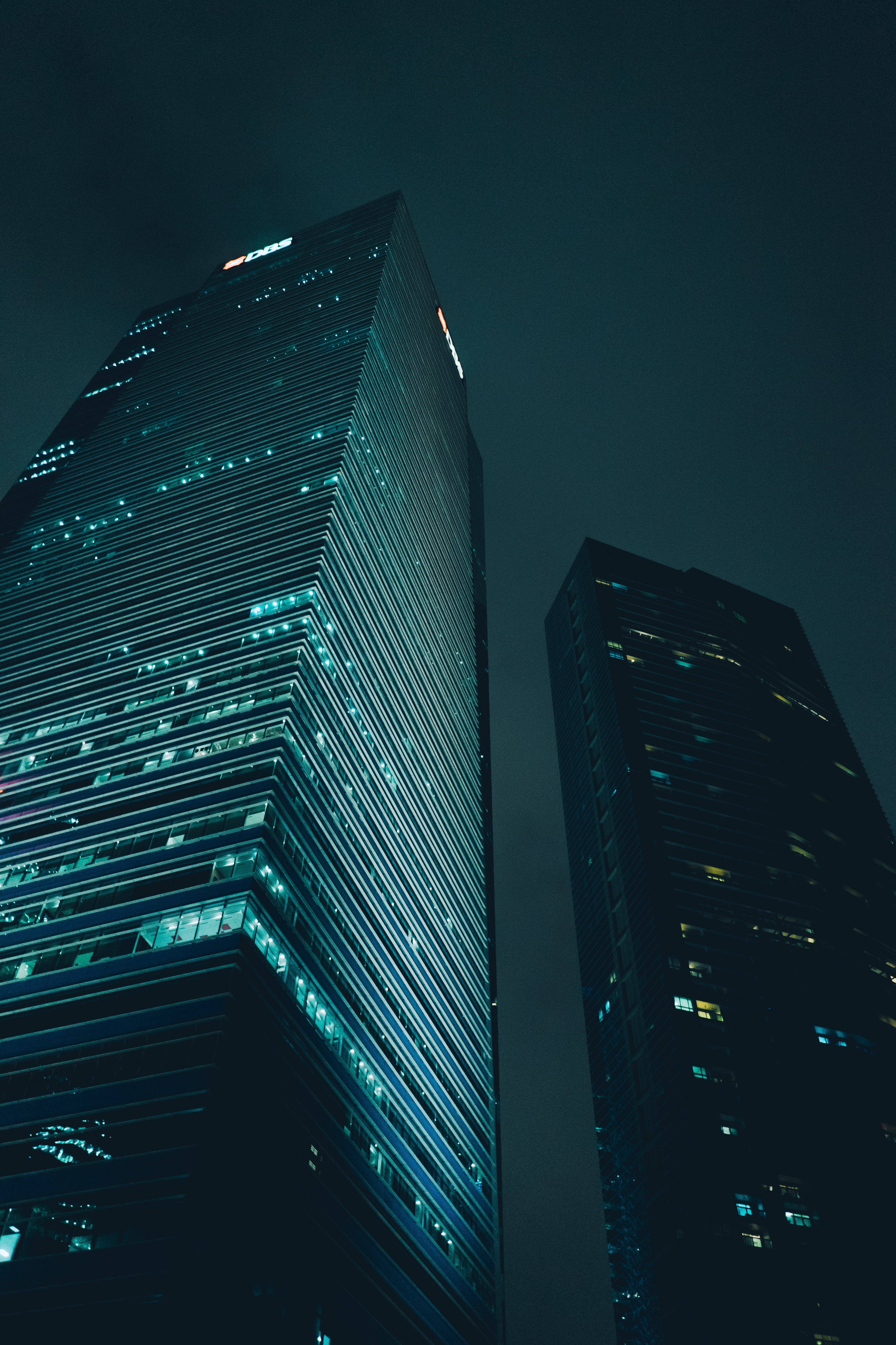 low-angle photography of high-rise buildings during nighttime