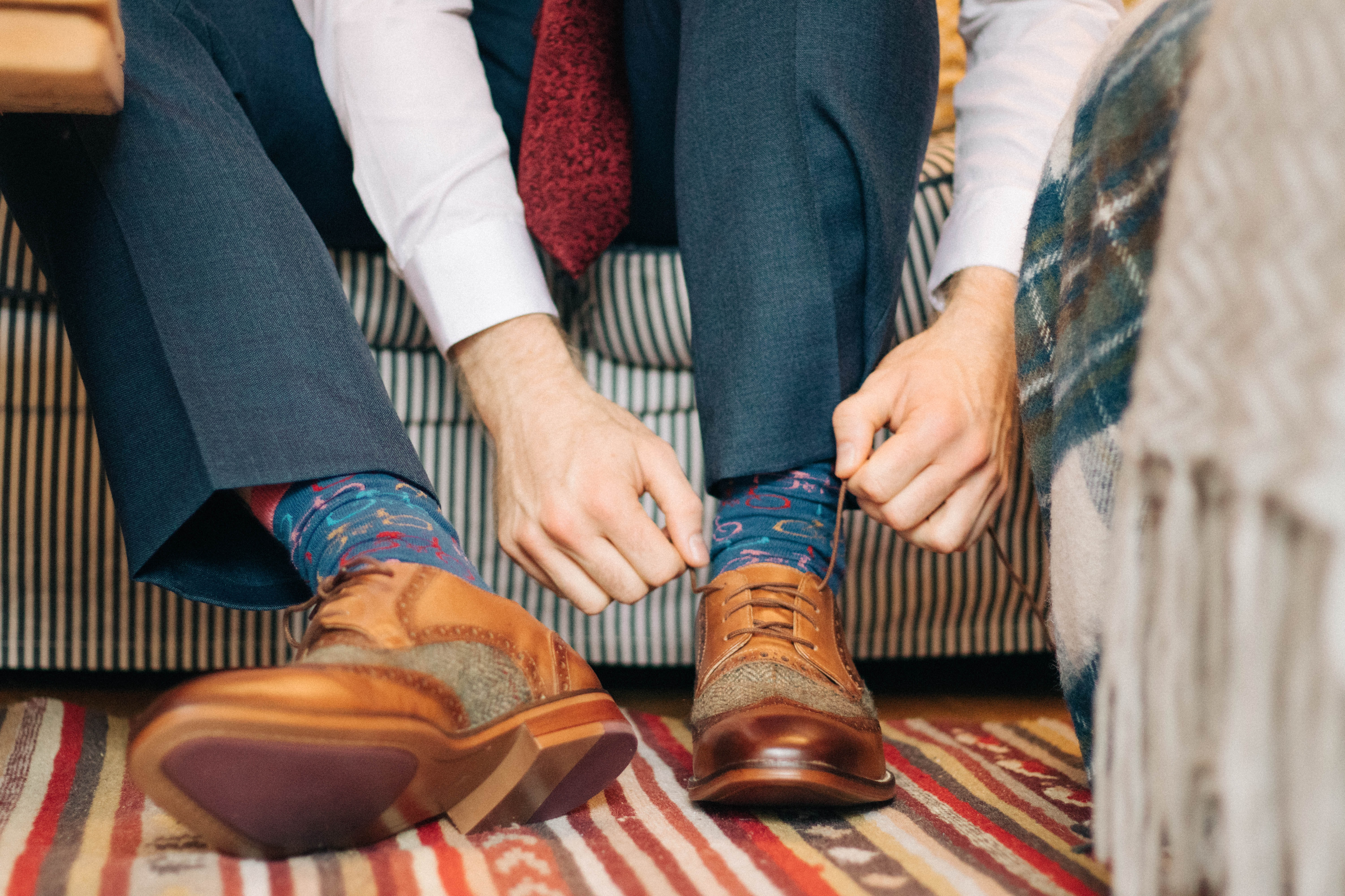 person holding shoe tie