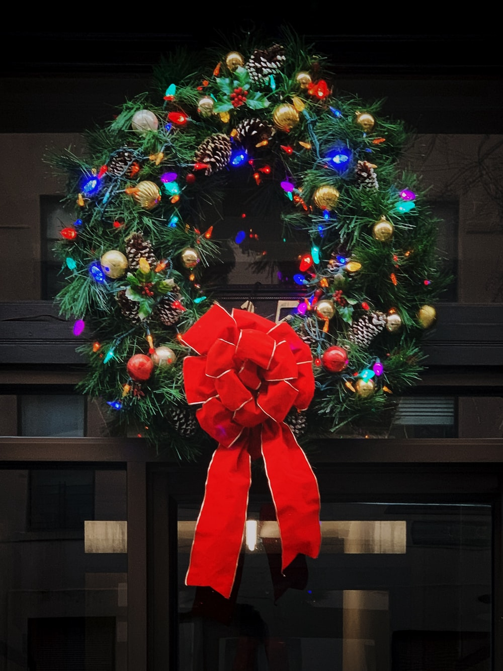 red and green Christmas wreath with baubles