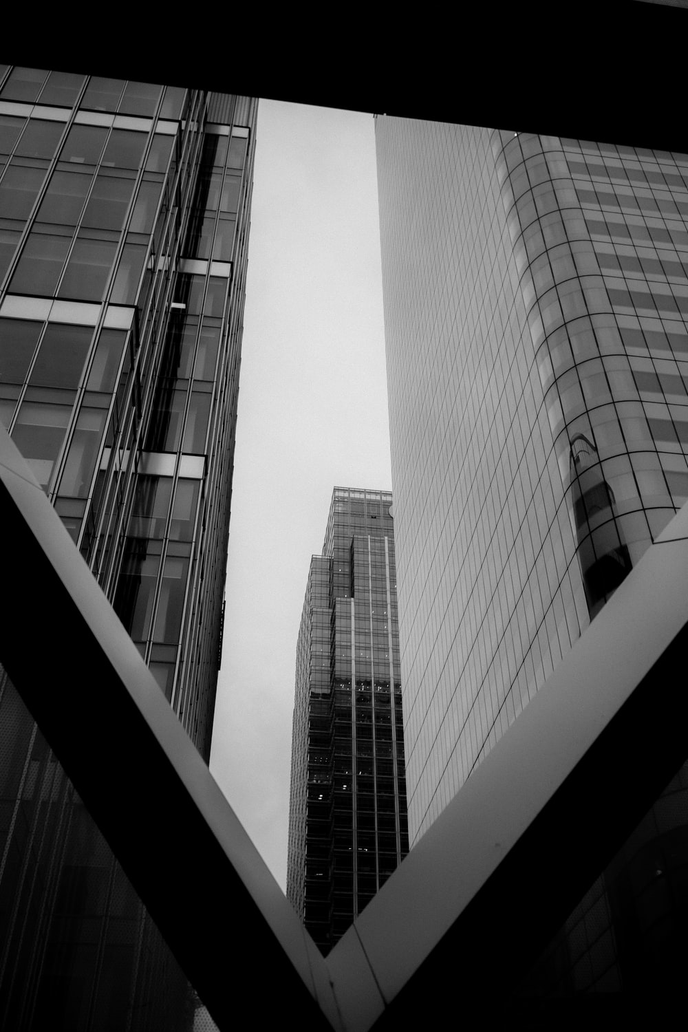 low angle photography of curtain buildings