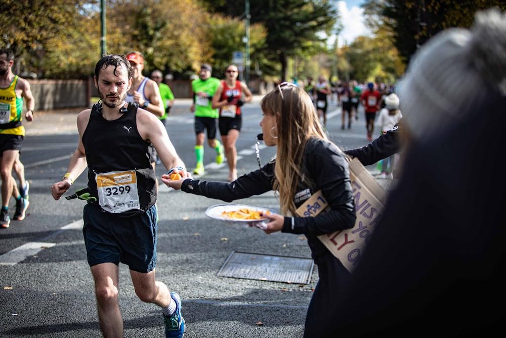 man running beside woman