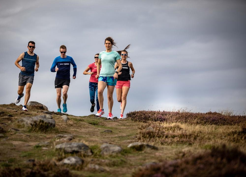 men and women running