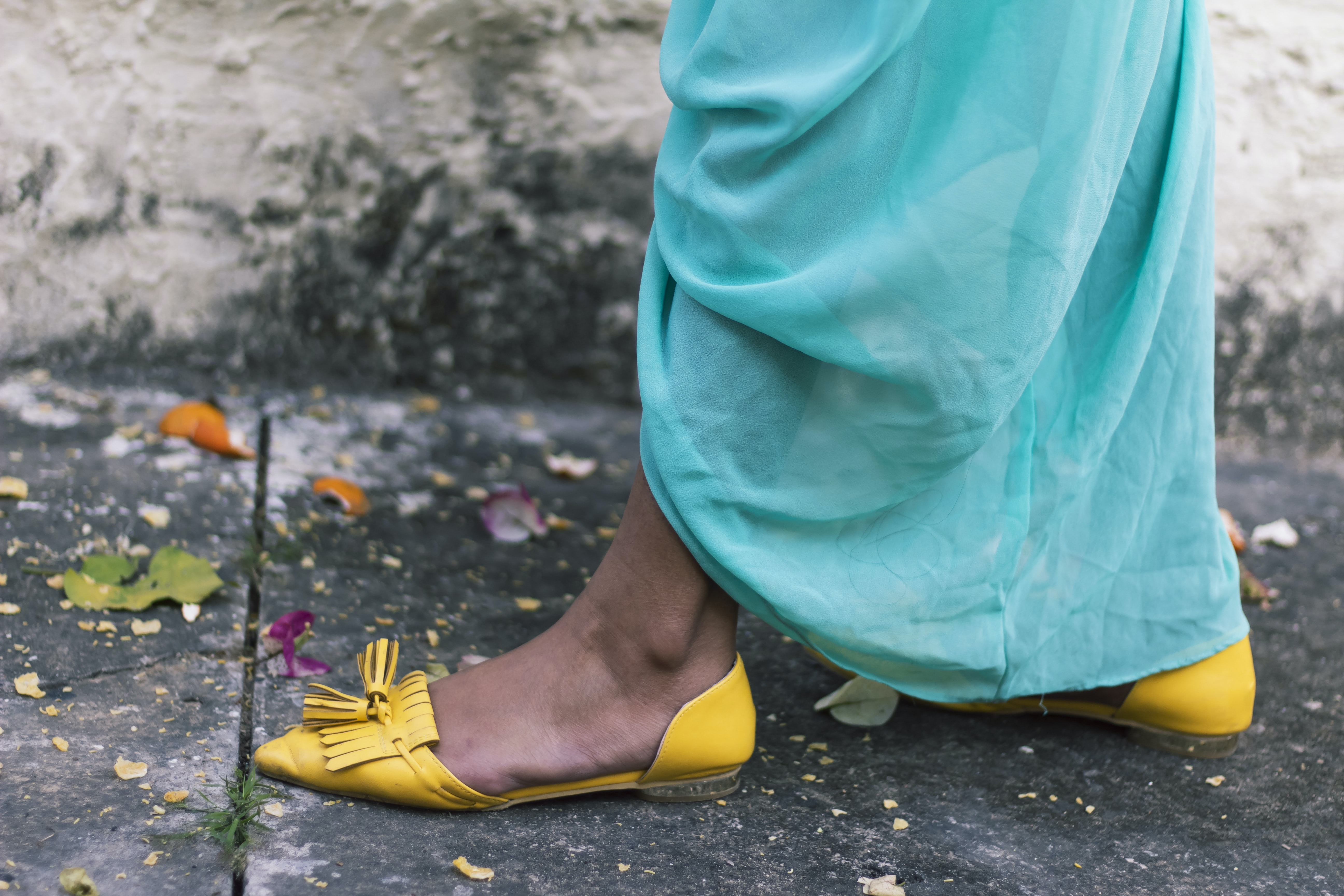 woman wearing yellow leather flats at daytime