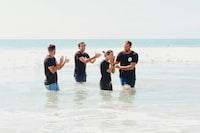 men standing in body of water