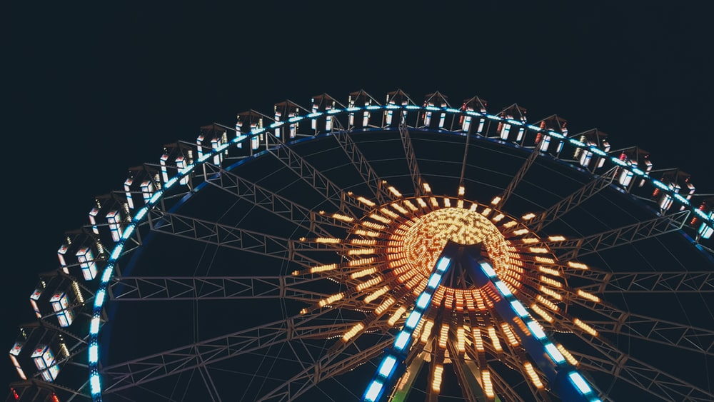 low angle photography of lighted ferris wheel