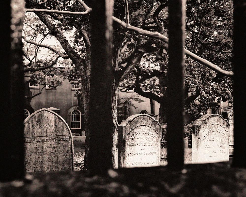 grayscale photo of tombstones