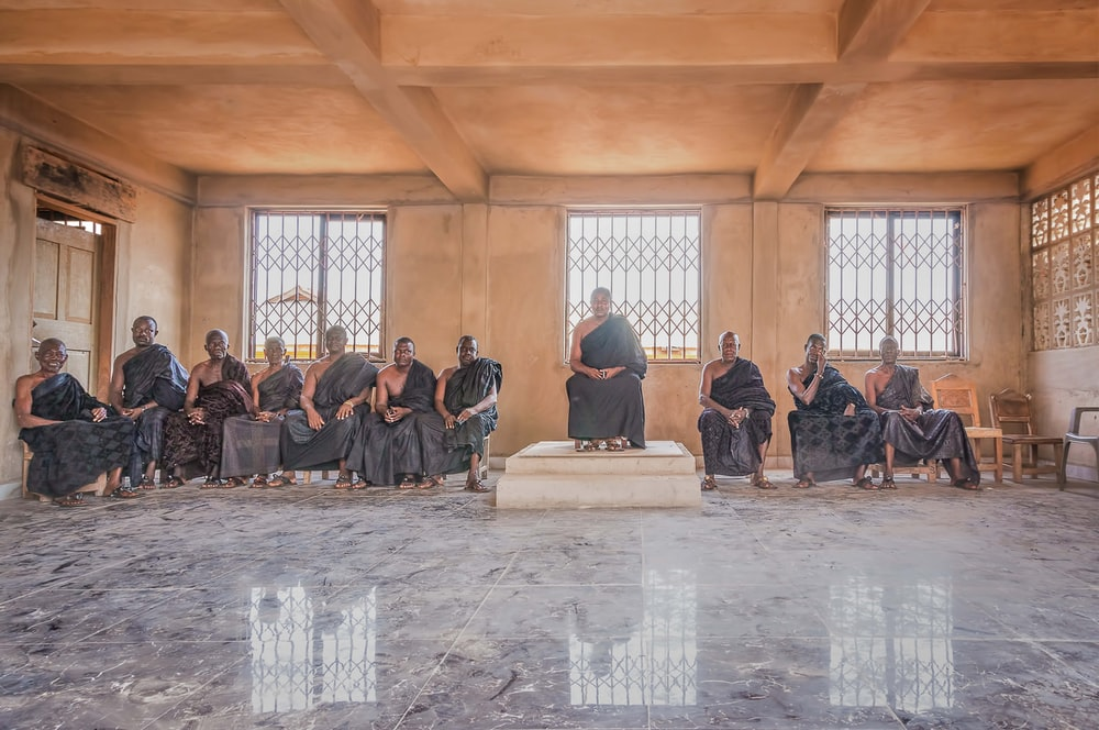 group of people sitting inside building