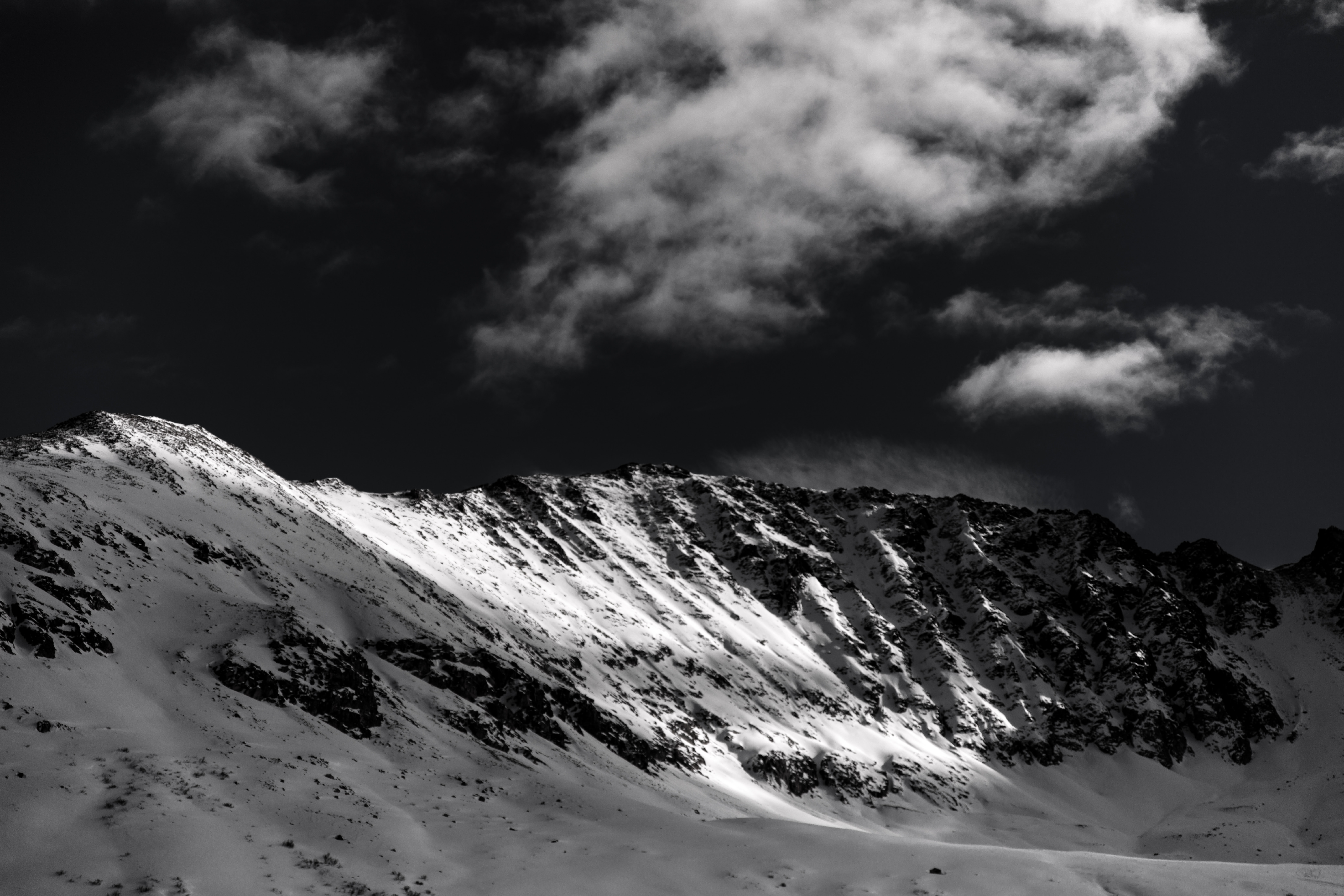 white snow covered mountain during daytime