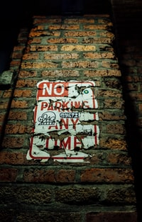 No Parking Any Time sign on wall